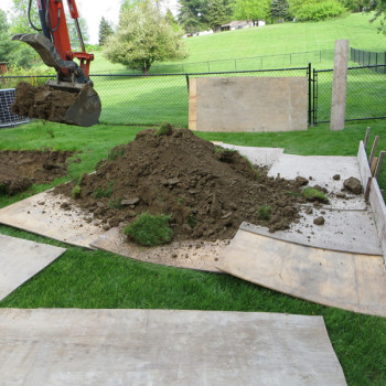 21-excavated-soil-on-plywood-to-protect-lawn-area
