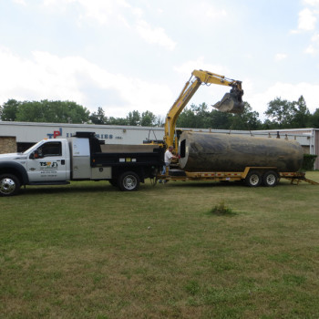 11-Loading-3000-gallon-Tank-for-disposal-6